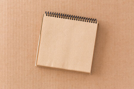 Notepad on cardboard background photo