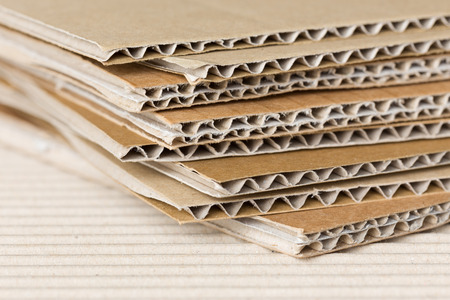 Pile of corrugated cardboard  Shallow DOF, macro shot  Stock Photo