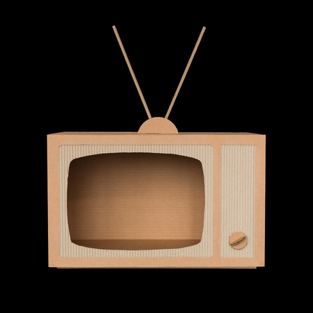 TV made of cardboard  Isolated on black  photo