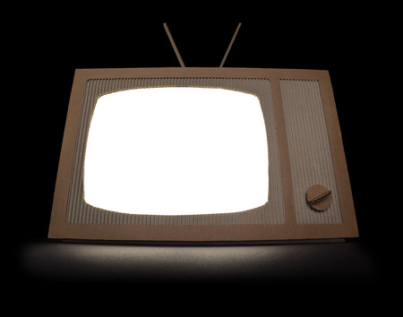TV made of cardboard with blank isolated screen  Isolated on black  photo
