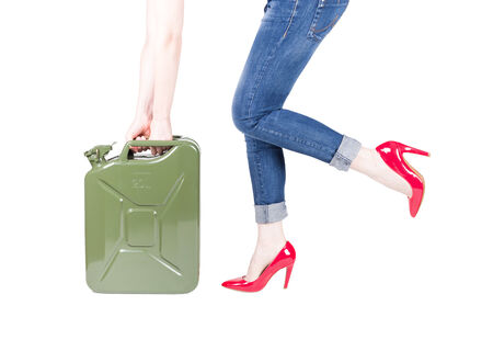 Woman with jerry can isolated on white photo
