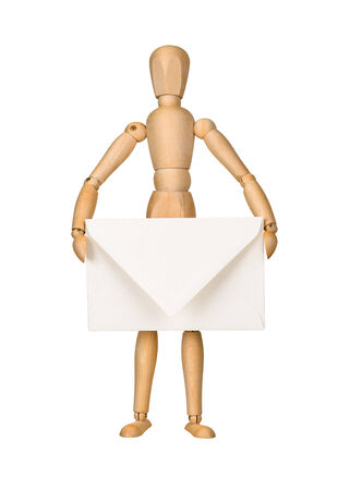 Wooden model dummy holding envelop, isolated on white  Mail concept  photo