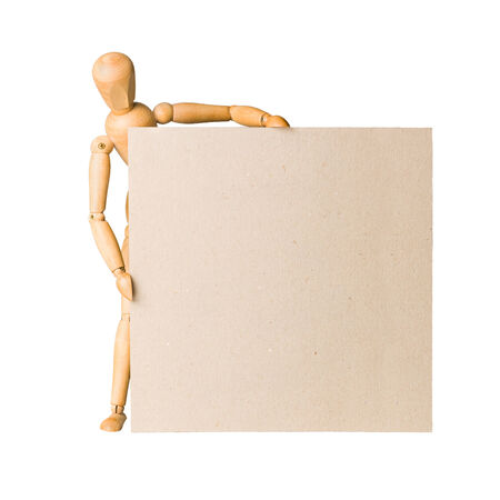 Wooden model dummy holding blank square carton board isolated on white   photo