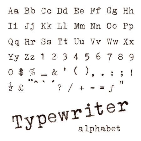 タイプライター文字白で隔離のタイプライター アルファベット マクロ写真
