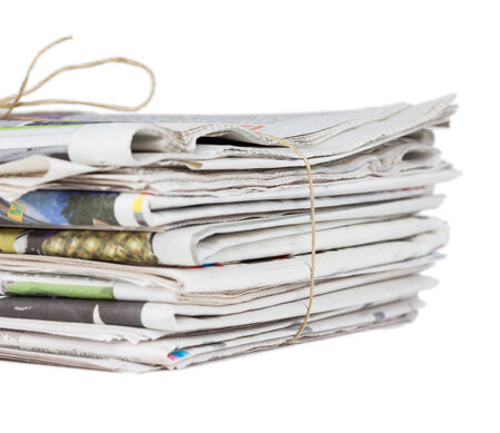 Pile of newspapers, tied with a string Stock Photo