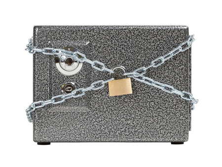 Closed safe, wrapped in chain  Keeping the money safe concept  photo