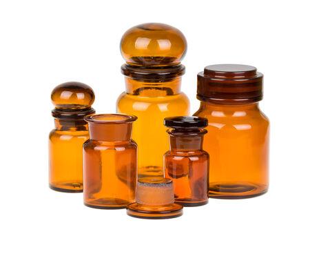naturopath: Empty vintage apothecary bottles isolated on white Stock Photo