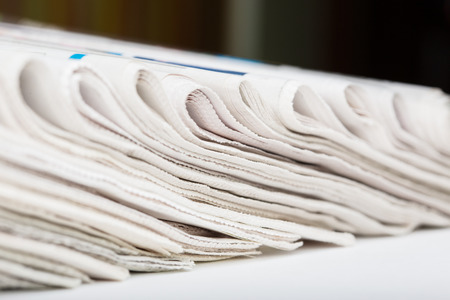 Assortment of folded newspapers closeup  Shallow DOF  photo