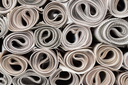 Stack of newspapers rolls, texture background  photo