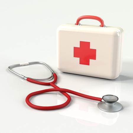 firstaid: First aid kit with stethoscope. White doctors bag with a cross with reflection. Emergency, healthcare, paramedic assistance concept. Stock Photo