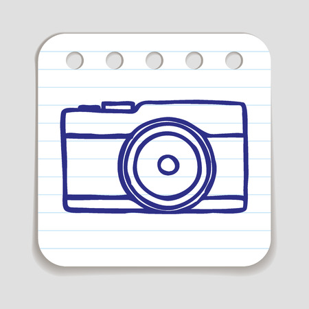 blue pen: Doodle Camera icon. Blue pen hand drawn infographic symbol on a notepaper piece.