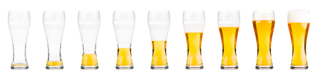half full: Glasses with beer showing a drinking sequence.