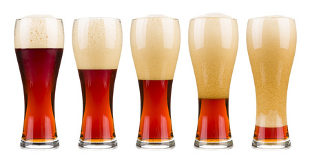Five glasses of red beer in filling up in sequence. Isolated on white. Stock Photo