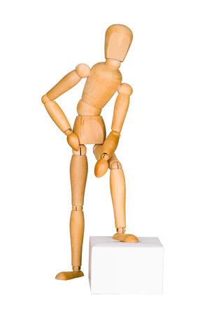 leaning on the truck: Wooden mannequin lean on the box.  Isolated on white. Stock Photo