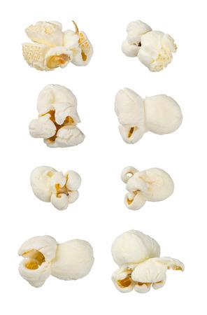 extra large: Single popcorns isolated on white. Extra large macro set. Extreme close up. Junk food, dessert, snack concept.