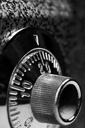 Combination lock. Black and white. Shallow DOF. Safety concept. Business, investment and data security