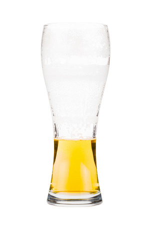 pewter mug: Half full beer glass. Light lager beer remains in a tall glass. Isolated on white background