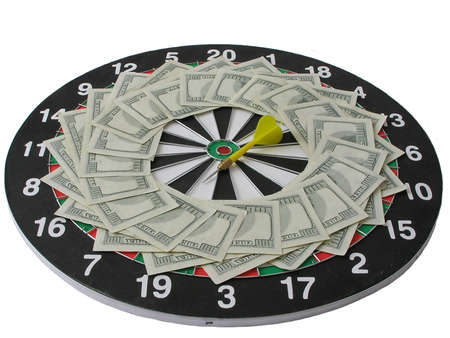 On a photo a target of a darts on which on a circle are spread out money. The photo is made in Ukraine photo