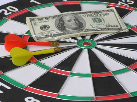 On a photo the target of a darts on which lays a pack of money. The photo is made in Ukraine photo