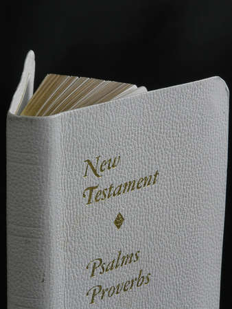 On a photo on a black background the New testament. The photo is made in Ukraine. Stock Photo - 920686