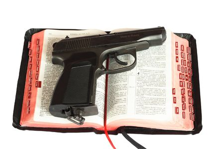 the gun on Bibles. Photo is isolated Stock Photo