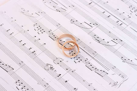 on photo two golden rings, which rest upon sheet with note