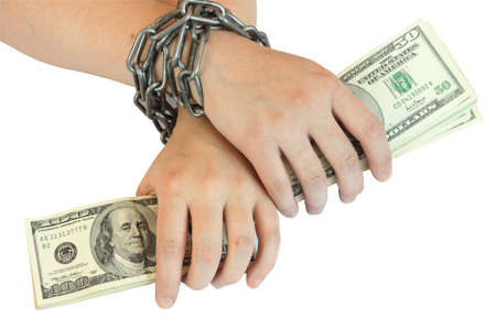 on photo of the hand bound by chain. In hand money.
