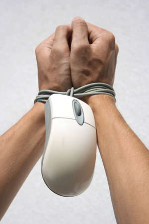 hands bound by mouse from computer
