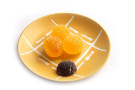 comfit: Yellow fruit candy on a plate Stock Photo
