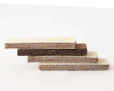 sweetness: Waffles with cocoa cream, arranged like building bricks, white background Stock Photo
