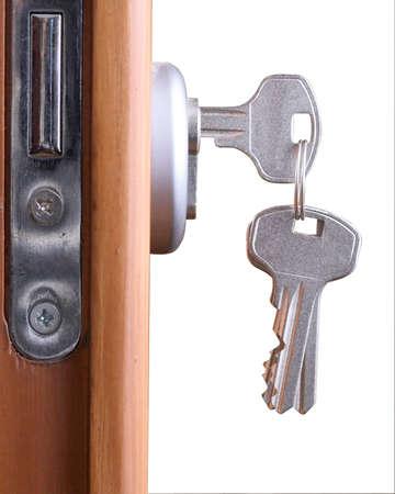 room door: A hotel room door lock and key.
