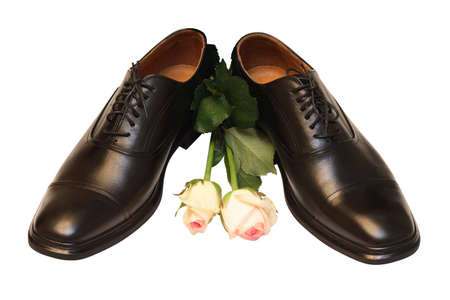 man shoes and roses on white background photo
