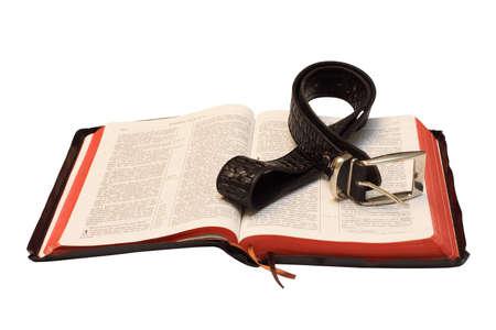 Blackenning leather Bible and belt on white background Stock Photo - 3713647