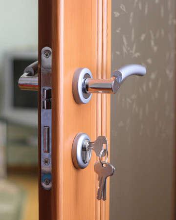 A hotel room door lock and key.