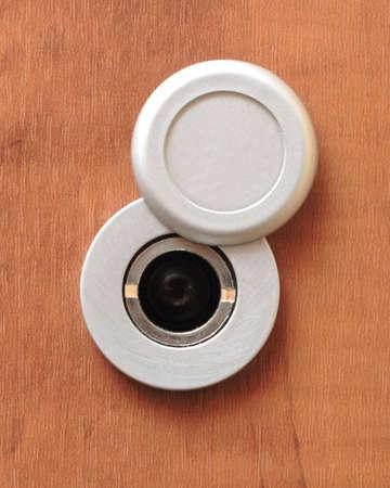 peephole: On a photo peephole on wooden door Stock Photo