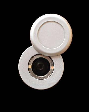 peephole: On a photo peephole on black background Stock Photo