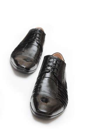 black shoes on white background photo