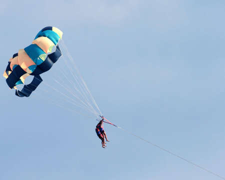 On a photo two persons with parachute