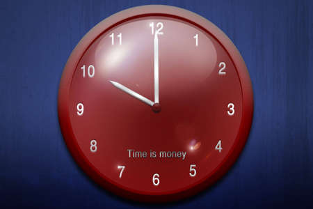 o'clock: beautiful red clock on a blue background Stock Photo