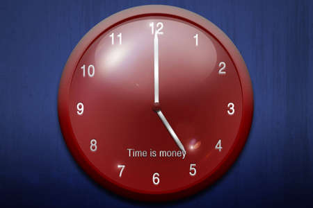 beautiful red clock on a blue background photo