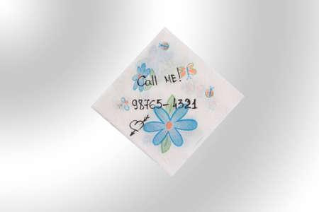 Napkin on blue background. The inscription on a napkin-Call me photo