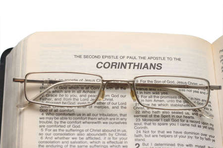 eyeglasses on the Bible. Isolated photo on white photo