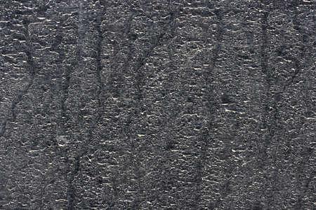 On a photo dust black car. Background photo