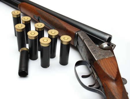 violence and trigger: Isolated shot of shotgun with ammunition Stock Photo