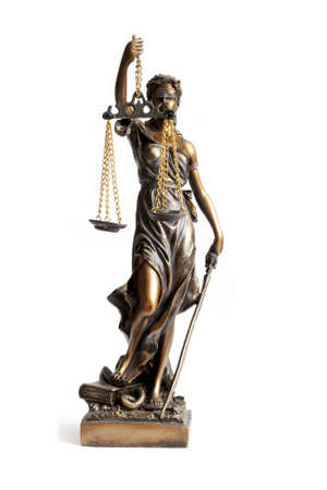 judiciary: Antique Statue of justice  Stock Photo