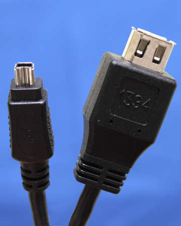 dataprojektor cable in black on a blue background photo