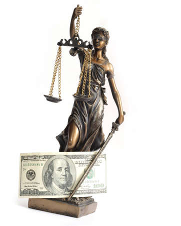 A statue of Themis with the dollar bill. photo
