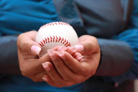 baseball in woman hand