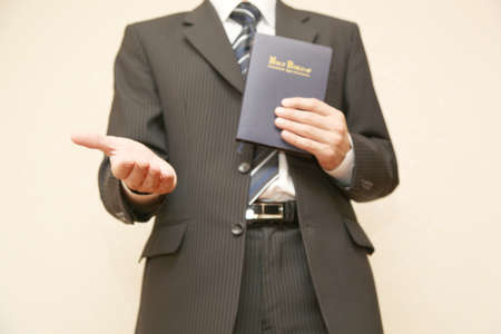 high priest: Man in suit with Holy Bible Stock Photo