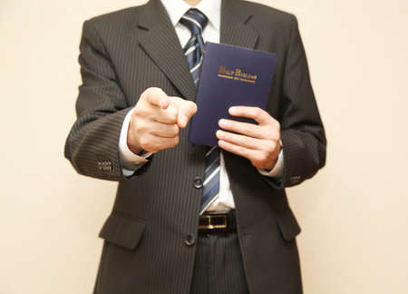 Man in suit with Holy Bible photo